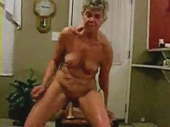Horny granny riding a big..