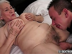 Granny Norma fucks a young guy